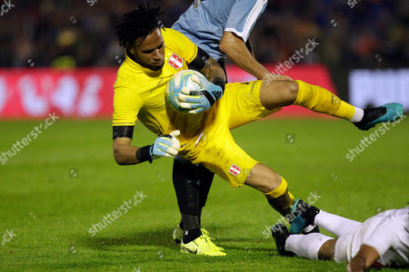 Peru's goalkeeper Pedro Gallese secures the ball during a friendly soccer match against Uruguay, in Montevideo, Uruguay