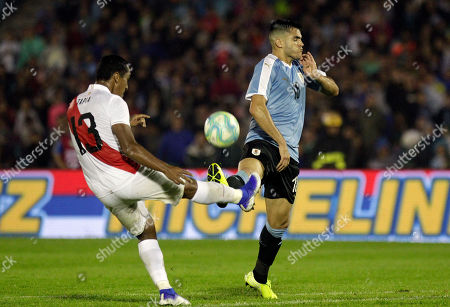 Stock Photo of Peru's Renato Tapia, left, fights for the ball with Uruguay's Maximiliano Gómez, during a friendly soccer match in Montevideo, Uruguay