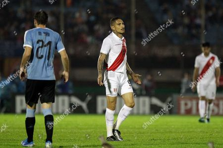 Peru's Paolo Guerrero, center, reacts during a friendly soccer match against Uruguay, in Montevideo, Uruguay