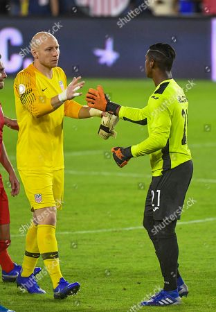 Stock Picture of USA goalkeeper Brad Guzan (L) shakes hands with Cuba goalkeeper Nelson Johnston (R) at the conclusion of the CONCACAF Nations League soccer match between the USA and Cuba at Audi Field in Washington, DC, USA, 11 October 2019.