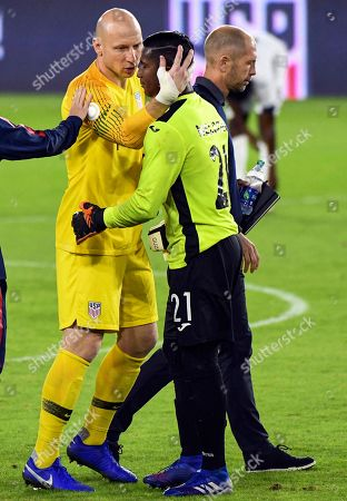 USA goalkeeper Brad Guzan (L) shakes hands with Cuba goalkeeper Nelson Johnston (R) at the conclusion of the CONCACAF Nations League soccer match between the USA and Cuba at Audi Field in Washington, DC, USA, 11 October 2019.