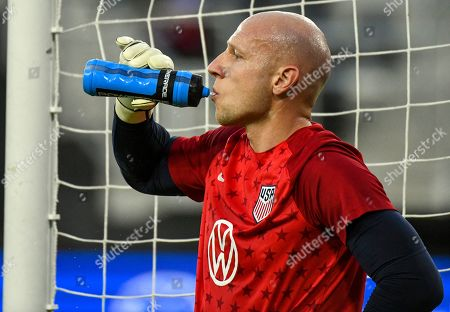 USA goalkeeper Brad Guzan drinks water after warming up prior to the start of the CONCACAF Nations League soccer match between the USA and Cuba at Audi Field in Washington, DC, USA, 11 October 2019.