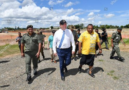 Australian Prime Minister Scott Morrison (C) walks with the Fiji Minister for Defence and National Security Inia Seruiratu (C-R) at the Blackrock Camp in Nadi, Fiji, 12 October 2019. Morrison is on a two visit to Fiji.