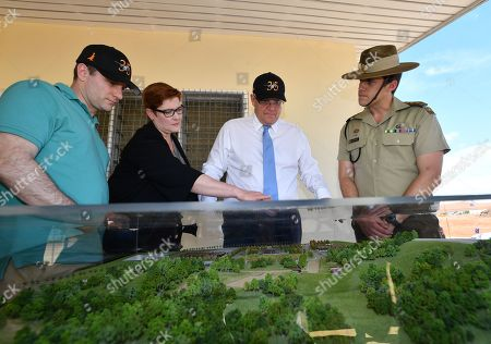 (L-R) Australian Minister for International Development and the Pacific Alex Hawke, Minister for Foreign affairs Marise Payne, Prime Minister Scott Morrison and ADF Officer Gerard Koen look over a model at the Blackrock Camp in Nadi, Fiji, 12 October 2019. Morrison is on a two visit to Fiji.