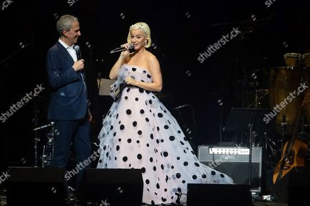 "Katy Perry, Bob Roth. Singer Katy Perry, left, and the CEO of the David Lynch Foundation Bob Roth speak on stage during the ""Silence the Violence"" Benefit Concert held at The Anthem, in Washington"