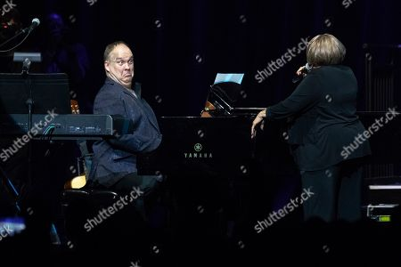 """Rob Mathes, Mavis Staples. Rob Mathes, left, of The Celebration Gospel Choir, performs on stage with Mavis Staples during the """"Silence the Violence"""" Benefit Concert held at The Anthem, in Washington"""