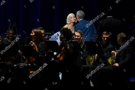 "Katy Perry, Bob Roth. Singer Katy Perry, left, is greeted on stage by the CEO of the David Lynch Foundation Bob Roth during the ""Silence the Violence"" Benefit Concert held at The Anthem, in Washington"