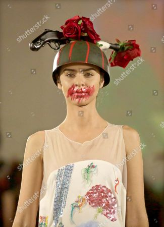 Stock Photo of A model presents a creation by Brazilian designer Ronaldo Fraga as part of his 'War and Peace' (Guerra y Paz) collection, inspired by the work of the painter Candido Portinari, and presented at Ixel Moda 2019 in Cartagena, Colombia, 11 October 2019.