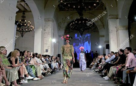 Stock Image of A model presents a creation by Brazilian designer Ronaldo Fraga as part of his 'War and Peace' (Guerra y Paz) collection, inspired by the work of the painter Candido Portinari, and presented at Ixel Moda 2019 in Cartagena, Colombia, 11 October 2019.