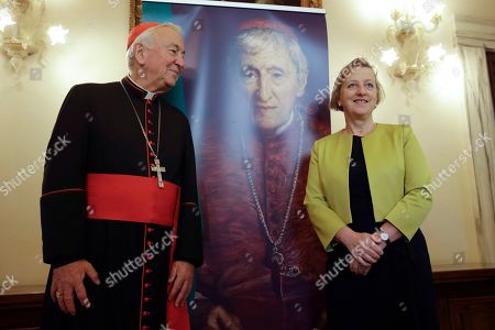Cardinal Vincent Nichols, left, poses for a photo with Sally Jane Axworthy, the British Ambassador to the Holy See, before the start of an event at the Vatican, to celebrate the Canonization of Cardinal John Henry Newman who will be named a Saint in a ceremony presided by Pope Francis on Sunday