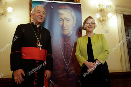 Cardinal Vincent Nichols, left, poses for a photo with Sally Jane Axworthy, the British Ambassador to the Holy See before the start of an event at the Vatican, to celebrate the Canonization of Cardinal John Henry Newman who will be named a Saint in a ceremony presided by Pope Francis on Sunday