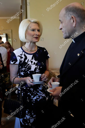 Stock Photo of Callista Louise Gingrich, the United States Ambassador to the Holy See, enjoys a coffee before the start of an event at the Vatican, to celebrate the Canonization of Cardinal John Henry Newman who will be named a Saint in a ceremony presided by Pope Francis on Sunday