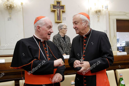 Cardinal Marc Ouellet, left, talks with Cardinal Vincent Nichols, before the start of an event at the Vatican, to celebrate the Canonization of Cardinal John Henry Newman who will be named a Saint in a ceremony presided by Pope Francis on Sunday