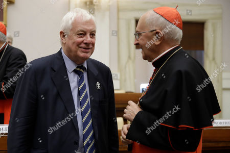 Christopher Francis Patten, Baron Patten of Barnes, left, shares a word with Cardinal Fernando Filoni before the start of an event at the Vatican, to celebrate the Canonization of Cardinal John Henry Newman who will be named a Saint in a ceremony presided by Pope Francis on Sunday