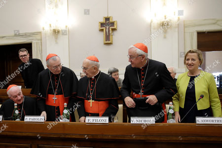 From left, Cardinals Marc Ouellet, Pietro Parolin, Fernando Filoni, Vincent Nichols and British Ambassador to the Holy See take their places before the start of an event at the Vatican, to celebrate the Canonization of Cardinal John Henry Newman who will be named a Saint in a ceremony presided by Pope Francis on Sunday