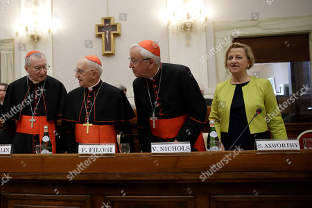 Stock Picture of From left, Cardinals Pietro Parolin, Fernando Filoni, Vincent Nichols and British Ambassador to the Holy See take their seats before the start of an event at the Vatican, to celebrate the Canonization of Cardinal John Henry Newman who will be named a Saint in a ceremony presided by Pope Francis on Sunday