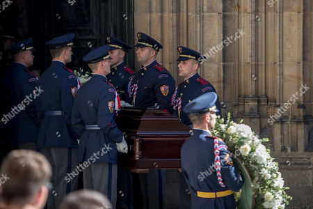 Members of Prague Castle Guard carry the coffin containing the body of late Czech singer Karel Gott after a funeral mass in the Saint Vitus Cathedral at the Prague Castle, in Prague, Czech Republic, 12 October 2019. Karel Gott died at the age of 80 shortly before midnight on 01 October 2019 following a long suffering of cancer.