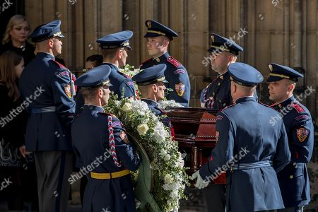 Members of the Prague Castle Guard carry the coffin containing the body of late Czech singer Karel Gott after a funeral mass in the Saint Vitus Cathedral at the Prague Castle, in Prague, Czech Republic, 12 October 2019. Karel Gott died at the age of 80 shortly before midnight on 01 October 2019 following a long suffering of cancer.