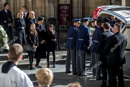 Widow Ivana Gottova (C-L, with veiled black hat) with her daughters watches members of the Prague Castle Guard loading the coffin containing the body of late Czech singer Karel Gott into a hearse after a funeral mass in the Saint Vitus Cathedral at the Prague Castle, in Prague, Czech Republic, 12 October 2019. Karel Gott died at the age of 80 shortly before midnight on 01 October 2019 following a long suffering of cancer. Others are not identified.