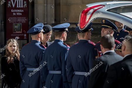 Widow Ivana Gottova (3-L) with one of her daughters (L) watches members of the Prague Castle Guard loading the coffin containing the body of late Czech singer Karel Gott into a hearse after a funeral mass in the Saint Vitus Cathedral at the Prague Castle, in Prague, Czech Republic, 12 October 2019. Karel Gott died at the age of 80 shortly before midnight on 01 October 2019 following a long suffering of cancer. Others are not identified.