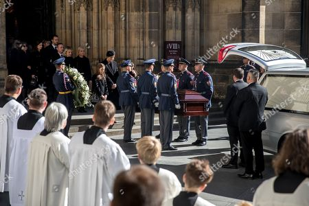 Widow Ivana Gottova (C-L, rear, with veiled black hat) with her daughters watches members of the Prague Castle Guard loading the coffin containing the body of late Czech singer Karel Gott into a hearse after a funeral mass in the Saint Vitus Cathedral at the Prague Castle, in Prague, Czech Republic, 12 October 2019. Karel Gott died at the age of 80 shortly before midnight on 01 October 2019 following a long suffering of cancer. Others are not identified.