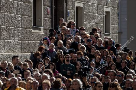 Mourners gather near the Saint Vitus Cathedral at the Prague Castle as they wait for the coffin containing the body of late Czech singer Karel Gott to be carried from a funeral mass to a waiting hearse, in Prague, Czech Republic, 12 October 2019. Karel Gott died at the age of 80 shortly before midnight on 01 October 2019 following a long suffering of cancer.