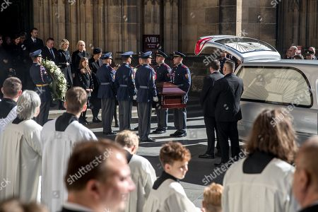 Widow Ivana Gottova (L, rear, with veiled black hat) with her daughters watches members of the Prague Castle Guard loading the coffin containing the body of late Czech singer Karel Gott into a hearse after a funeral mass in the Saint Vitus Cathedral at the Prague Castle, in Prague, Czech Republic, 12 October 2019. Karel Gott died at the age of 80 shortly before midnight on 01 October 2019 following a long suffering of cancer. Others are not identified.