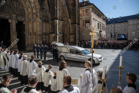 Members of the Prague Castle Guard salute behind a hearse as the coffin containing the body of late Czech singer Karel Gott is about to be carried out from a funeral mass in the Saint Vitus Cathedral at the Prague Castle, in Prague, Czech Republic, 12 October 2019. Karel Gott died at the age of 80 shortly before midnight on 01 October 2019 following a long suffering of cancer.