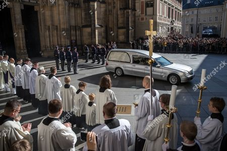 Members of the Prague Castle Guard stand at attention as a hearse carrying the coffin containing the body of late Czech singer Karel Gott leaves from funeral mass outside the Saint Vitus Cathedral at the Prague Castle, in Prague, Czech Republic, 12 October 2019. Karel Gott died at the age of 80 shortly before midnight on 01 October 2019 following a long suffering of cancer.