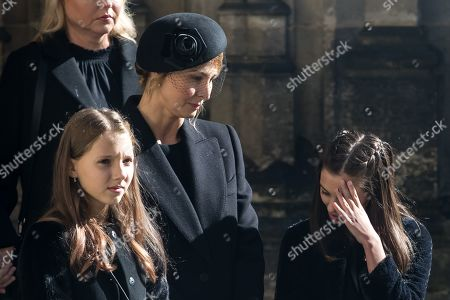 Widow Ivana Gottova (C) with her daughters watches members of the Prague Castle Guard loading the coffin containing the body of late Czech singer Karel Gott into a hearse after a funeral mass in the Saint Vitus Cathedral at the Prague Castle, in Prague, Czech Republic, 12 October 2019. Karel Gott died at the age of 80 shortly before midnight on 01 October 2019 following a long suffering of cancer. Others are not identified.