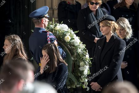 Stock Image of Widow Ivana Gottova (R) with her daughters (L) leaves after a funeral mass for late Czech singer Karel Gott in the Saint Vitus Cathedral at the Prague Castle, in Prague, Czech Republic, 12 October 2019. Karel Gott died at the age of 80 shortly before midnight on 01 October 2019 following a long suffering of cancer. Others are not identified.