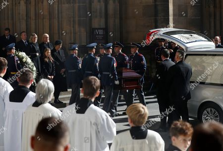 Ivana Gottova, stands behind a coffin with her husband, late famous Czech pop singer Karel Gott as its carried by the guard of honor after a funeral mass served at the St. Vitus Cathedral at the Prague Castle, Czech Republic