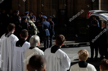 Stock Picture of Guard of honor carries a coffin with late famous Czech pop singer Karel Gott after a funeral mass served at the St. Vitus Cathedral at the Prague Castle, Czech Republic