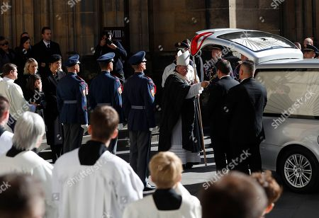 Archbishop of Prague Dominik Duka blesses a coffin with late famous Czech pop singer Karel Gott after a funeral mass served at the St. Vitus Cathedral at the Prague Castle, Czech Republic
