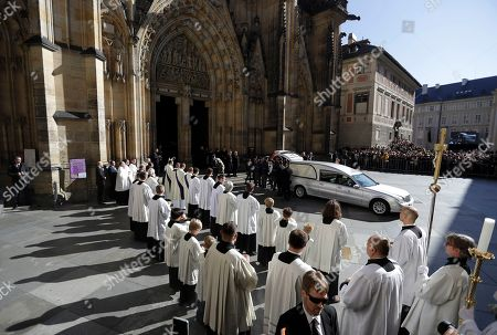 Stock Photo of Guard of honor carries a coffin with late famous Czech pop singer Karel Gott after a funeral mass served at the St. Vitus Cathedral at the Prague Castle, Czech Republic