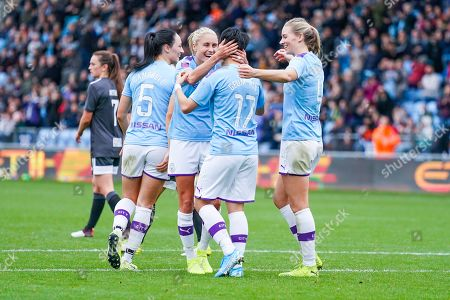 Manchester City Women forward Lee Geum-min (17) scores a goal and celebrates with team mates and Manchester City Women defender Steph Houghton (captain) (6)  to make the score 3-0 during the FA Women's Super League match between Manchester City Women and BIrmingham City Women at the Sport City Academy Stadium, Manchester