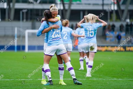 Manchester City Women forward Tessa Wullaert (25) scores a goal and celebrates with Manchester City Women defender Steph Houghton (captain) (6) to make the score 2-0 during the FA Women's Super League match between Manchester City Women and BIrmingham City Women at the Sport City Academy Stadium, Manchester