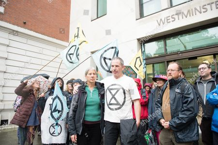 Extinction Rebellion protester and former Paralympic cyclist James Brown with his wife after being granted conditional bail by District judge John Zani with a one mile restriction from any airport in the UK.  He will be appearing at Southwark Crown Court in London on November 8 for his trial.