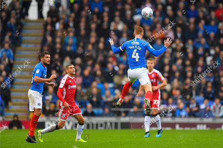 Stock Picture of Tom Naylor of Portsmouth with a clearance header during Portsmouth vs Gillingham, Sky Bet EFL League 1 Football at Fratton Park on 12th October 2019