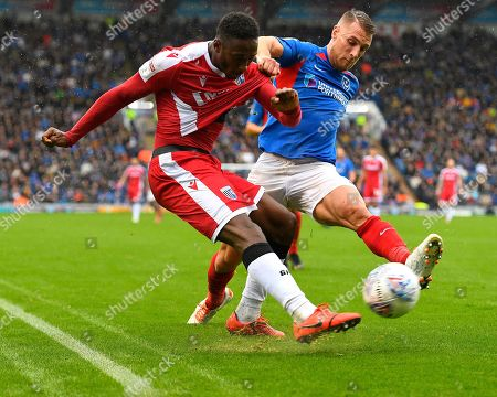 Stock Image of Lee Brown of Portsmouth takes a hold on Brandon Hanlan of Gillingham during Portsmouth vs Gillingham, Sky Bet EFL League 1 Football at Fratton Park on 12th October 2019