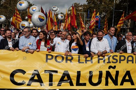 Stock Photo of Members of Ciudadanos party Ines Arrimadas (5-R), Carlos Carrizosa (4-L), Jose Manuel Villegas (2-L) and Lorena Roldan (3-L) march behind a banner reading 'For the Spanishness' during a demonstration in support of the Spanish unity on the occasion of the National Day, in Barcelona, Spain, 12 October 2019.