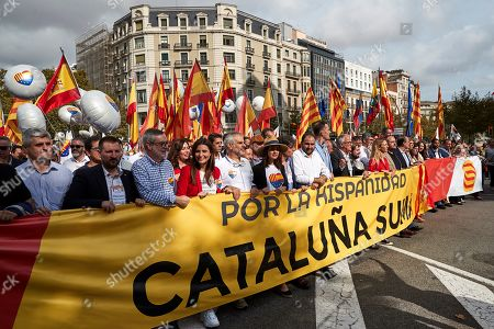 Ciudadanos party's parliamentary spokesperson Ines Arrimadas (C) marches behind a banner reading 'For the Spanishness in Catalonia' during a demonstration in support of the Spanish unity on the occasion of the National Day, in Barcelona, Spain, 12 October 2019.