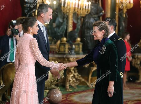 Spain's King Felipe VI (2-L) and Queen Letizia (L) welcome Spanish soprano Ainhoa Arteta (2-R) for an official reception at the Royal Palace on the occasion of the Spanish National Day, in downtown Madrid, Spain, 12 October 2019.