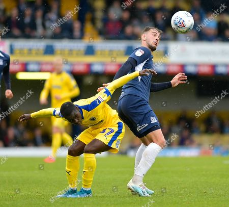 Stock Picture of Brandon Goodship of Southend United and Paul Osew of AFC Wimbledon battle for the ball
