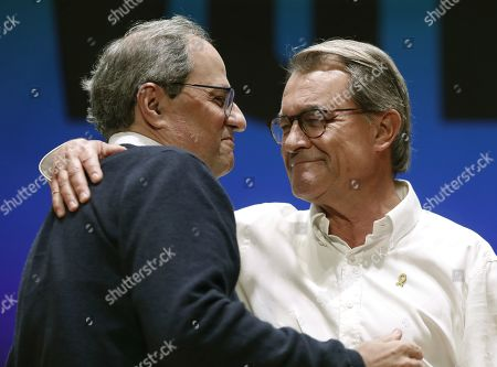 Catalan regional President Quim Torra (L) greets former Catalan President Artur Mas during a rally of the pro-independence party Junts per Catalunya (JxCat) held in Tarrasa, province of Barcelona, Spain, 12 October 2019. The event was held ahead of the upcoming general elections on 10 November under the motto 'Against the Sentence, Independence'. Former Catalan president Carles Puigdemont, who fled the country after being charged with rebellion, sedition and misuse of public funds for organising an independence referendum, participated via video conference from Brussels.