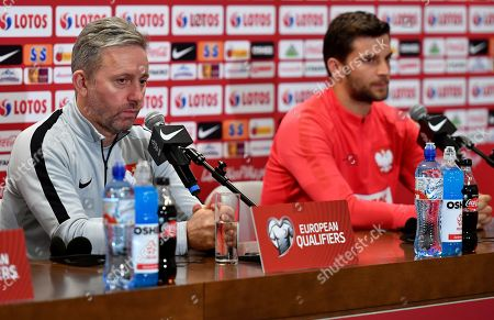 Polish national soccer team head coach Jerzy Brzeczek (L) and his player Bartosz Bereszynski (R) attend a press conference in Warsaw, Poland, 12 October 2019. Poland will face North Macedonia in the UEFA EURO 2020 qualifying soccer match on 13 October 2019 in Warsaw.