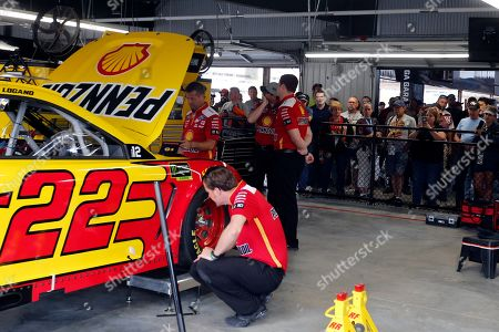 Fans watch the crew for Joey Logano in the new garage facilities during practice for the NASCAR Cup Series auto race at Talladega Superspeedway, in Talladega, Ala