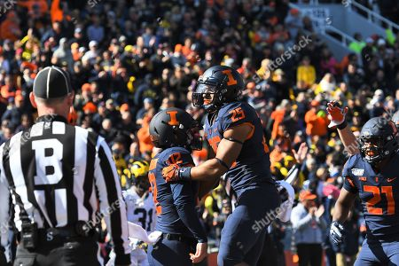 Illinois Fighting Illini running back Dre Brown (25) celebrates with Illinois Fighting Illini quarterback Matt Robinson (12) after scoring a touchdown during the NCAA Big Ten conference football game between the Illinois vs Michigan at Memorial Stadium in Champaigne, Illinois