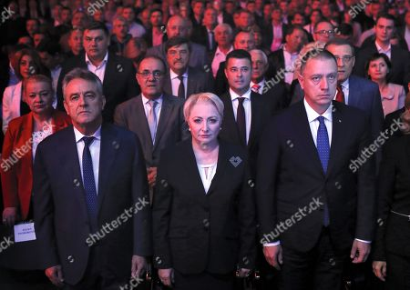 Acting Romanian Prime Minister and president of the ruling Social Democratic Party (PSD), Viorica Dancila, accomanied by her husband Cristinel (L) and by Mihai Fifor, interim vice-premier (R), observes the national anthem during an event held at Romexpo exposition center in Bucharest, Romania, 12 October 2019, three days after her government lost a vote of confidence in parliament. Dancila has been nominated as the PSD's candidate for the 2019 presidential elections, that will be held on 10 November 2019.
