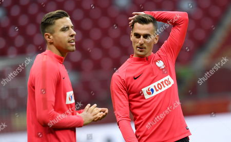 Polish national soccer team players Arkadiusz Milik (R) and Jan Bednarek (L) attend a team's training session in Warsaw, Poland, 12 October 2019. Poland will face North Macedonia in the UEFA EURO 2020 qualifying soccer match on 13 October 2019 in Warsaw.